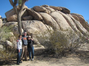 Posing with Joshua Tree and rocks at Quail Springs