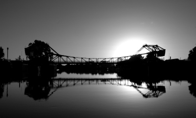 Walnut Grove Bridge taken from dock with sun setting behind.