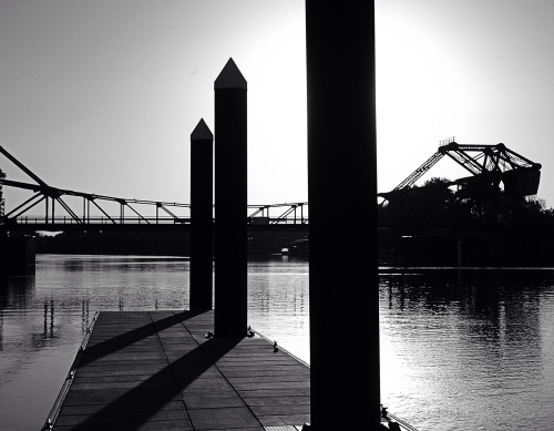 Boat dock at Walnut Grove with bridge beyond.