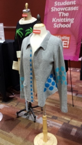 Sweater designs displayed at entrance t Vogue Knitting Live