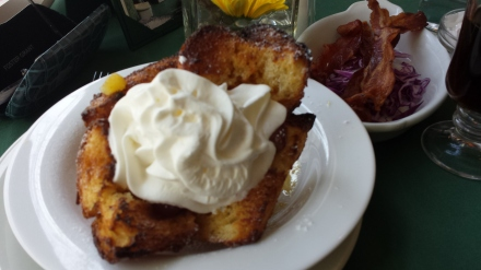 Brioche French toast with side of bacon at Polo Cafe