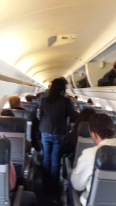 Sorry for the blur. There is little headroom for your average United passenger and even less leg room.