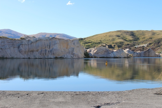 You can swim and picnic by St Bathans' Blue Lake.