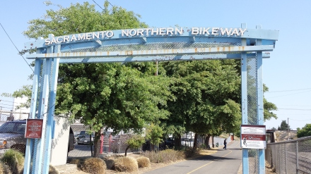 The entrance to the bike trail is just behind Blue Diamond Almond factory on C Street.