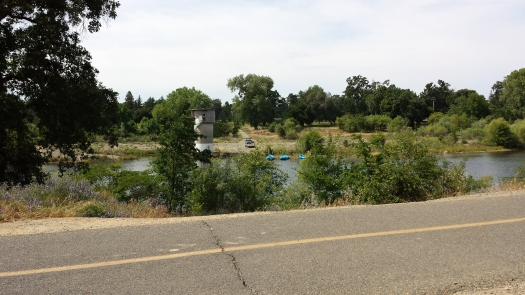 The paved bike path hugs the American River. Many river rafters pull their boats out at Ancil Hoffman park.