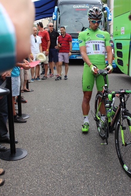 "Peter Sagan fine tunes his bike before a stage. He is wearing his ""second skin"" the green jersey."