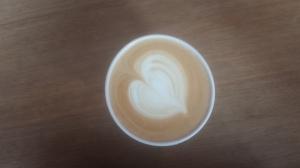 Heart foam art on latte from Heart.