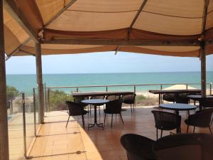 The outdoor area overlooking the ocean at Eco Beach Resort