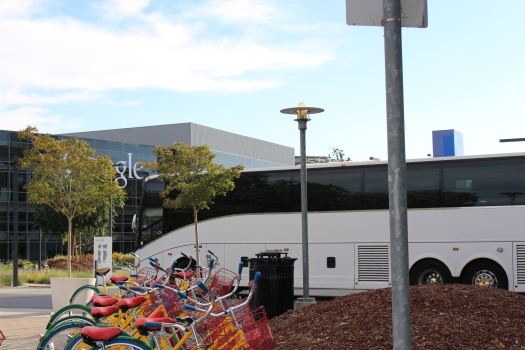 Google provides alternative transportation: bikes for around the Google campus and buses for the employee commute.