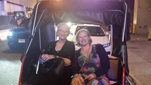 Mom and American Julie in bicycle rickshaw.