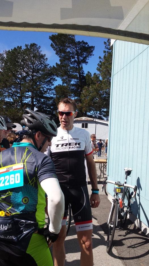 Jens Voigt talking to riders and fans about his bike.