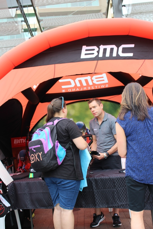 Signing autographs at BMC booth.